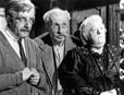 Margaret Rutherford as Mrs Fazackalee from original film